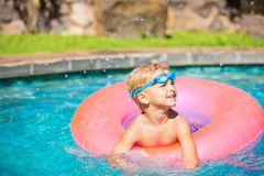 Kid Having Fun in Swimming Poo Royalty Free Stock Images