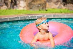 Kid Having Fun in Swimming Poo Royalty Free Stock Images