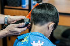 Kid having a haircut Royalty Free Stock Images