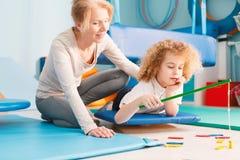 Kid having sensory integration session Stock Photos