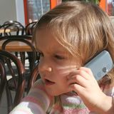 Kid having a telephone call stock photography
