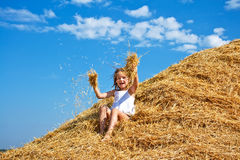 Kid in a haystack Royalty Free Stock Image