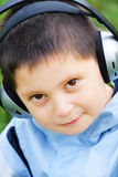 Kid in headphones Stock Images