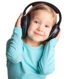 Kid in headphones Stock Photo