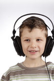Kid with headset Stock Photos