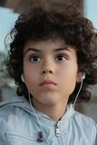 Kid with headset Royalty Free Stock Image
