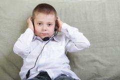Kid with headset phone Stock Photography