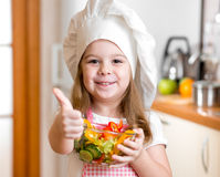 Kid with healthy food and showing thumb up stock images