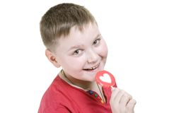 Kid with heart shaped lolly pop Stock Image