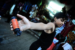 Kid in Hebron market. Showing tear gas shell shot by Israel soldiers Royalty Free Stock Photos