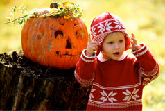 Kid and Helloween Pumpkin Royalty Free Stock Photography