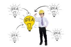 Kid with helmet drawing lightbulb Royalty Free Stock Photo