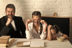 Kid and her tutors with tired, tricky and confident faces Royalty Free Stock Photos