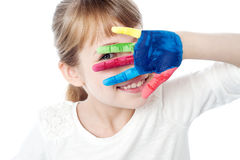 Kid hiding face with her colored hand. Beautiful girl hiding her face from camera Stock Photo