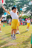 Kid high jumping in Kindergarten sport day Stock Images