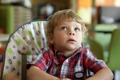 Kid in highchair Stock Photo
