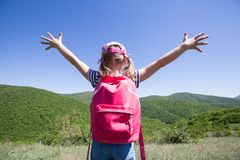 Kid in a hike. Little girl enjoys a beautiful view of a hike through the mountains Royalty Free Stock Images