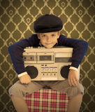 Kid with his cassette player. In sepia tones Royalty Free Stock Image