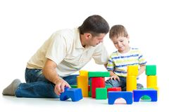 Kid and his dad play toys together Stock Photography