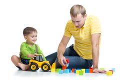 Kid and his dad repair toy tractor Stock Photos