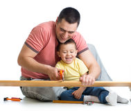 Kid and his dad work together Royalty Free Stock Photography