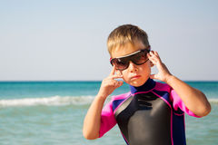 Kid in his diving suit and glasses at the beach Stock Image