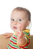 Kid with his finger pointing. Royalty Free Stock Images