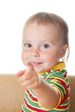 Kid with his finger pointing. Royalty Free Stock Photography