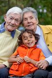 Kid with his grandparents Royalty Free Stock Photography