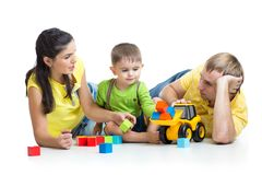 Kid with his parents play building blocks Stock Photo
