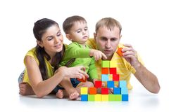 Kid with his parents play building blocks Royalty Free Stock Images