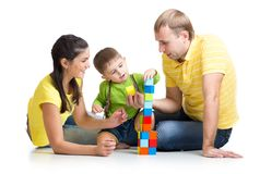 Kid with his parents playing building blocks Royalty Free Stock Images
