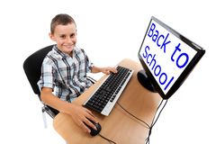 Kid at his pc. Monitor can be used as copyspace. Stock Photography