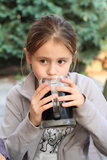 Kid hodling drink Stock Photo