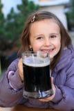 Kid hodling drink Stock Photos