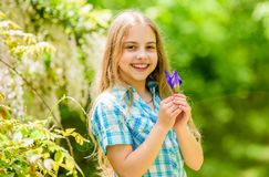 Kid hold flowers. Girl cute adorable teen nature background. Summer garden flower. Sunny summer day in nature. Walking. In green park. Collecting flowers in stock photos