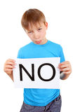 Kid hold Slogan NO Stock Image