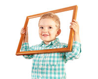 Kid hold wooden picture frame on white background. Happy kid holding a wooden picture frame on white background Royalty Free Stock Photo