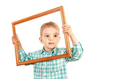 Kid hold wooden picture frame on white background Stock Photo