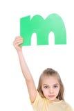 Kid holding alphabet letter Royalty Free Stock Photos