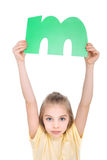 Kid holding alphabet letter Stock Images