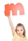 Kid holding alphabet letter Royalty Free Stock Photo