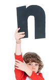 Kid holding alphabet letter Royalty Free Stock Photography
