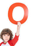 Kid holding alphabet letter Royalty Free Stock Image