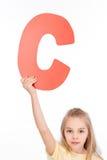 Kid holding alphabet letter Stock Photography