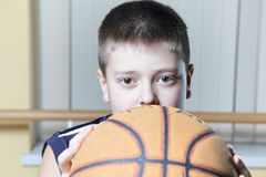 Kid holding basketball Stock Images