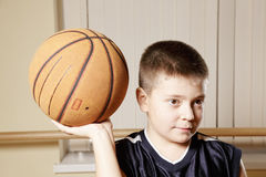 Kid holding basketball on palm Stock Photography