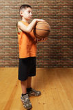 Kid holding basketball Royalty Free Stock Photos