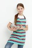 Kid holding bowl Stock Photography