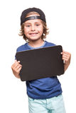 Kid holding a chalkboarb Stock Image